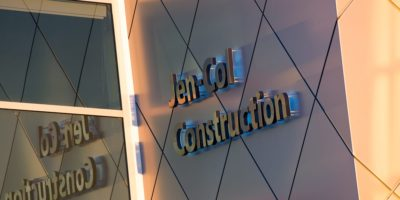 JEN COL Construction exterior wall with signage