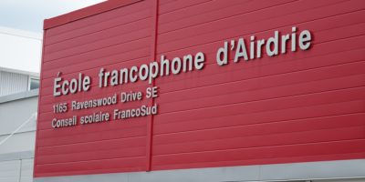 École Francophone Airdrie School exterior with signage