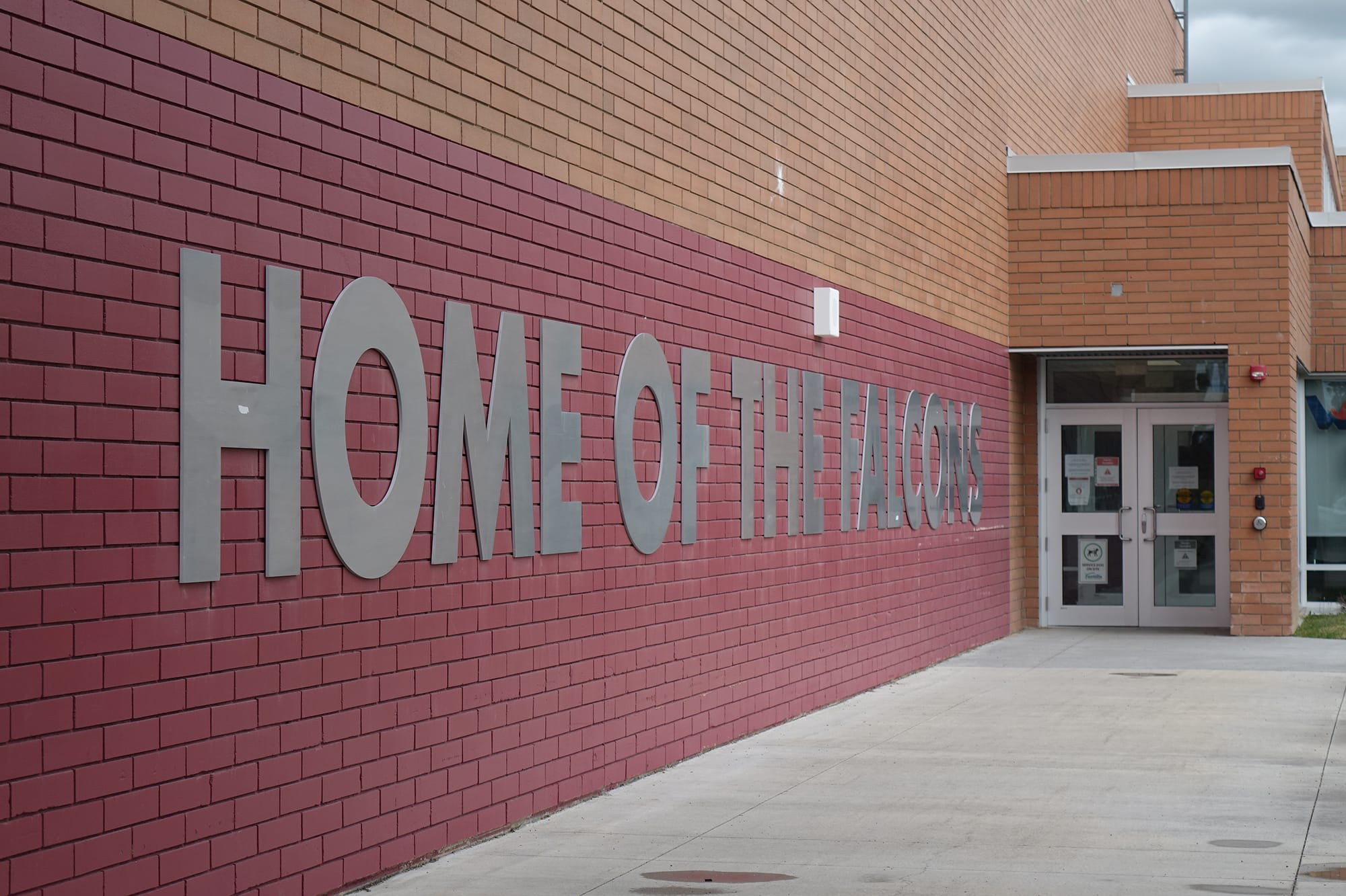 Foothills Composite High School wall with home of the Falcons