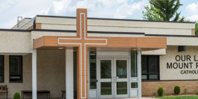 Our Lady of Mount Pleasant School exterior front entrance with cross