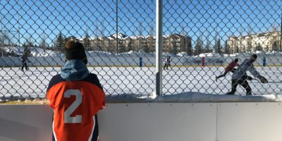 Tri Leisure Centre Outdoor Arena with a hockey player watching the play
